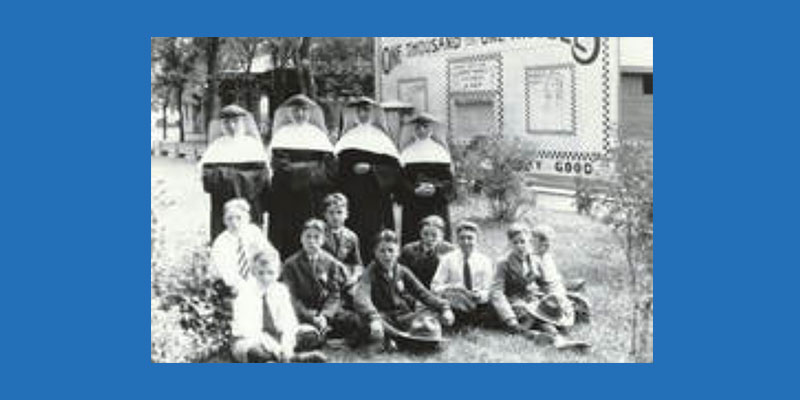black and white photo of sisters with students