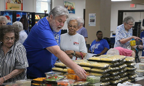 residents getting food at community food pantry