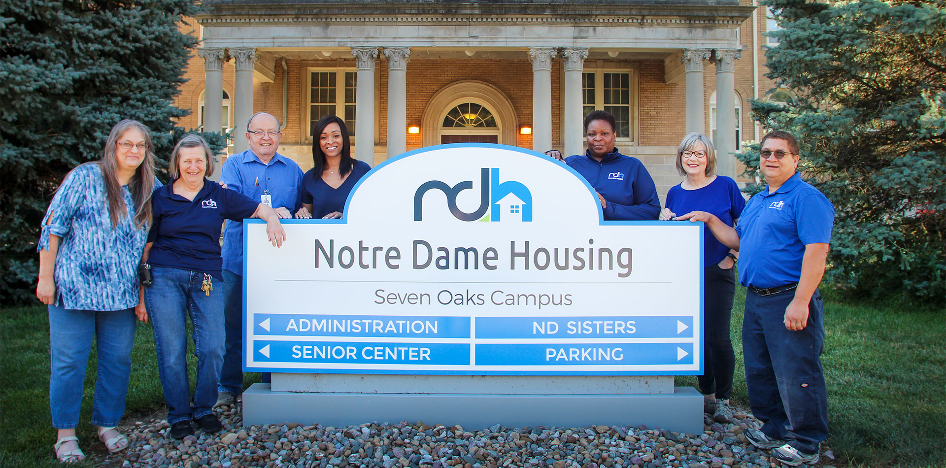 ndh staff standing by exterior sign