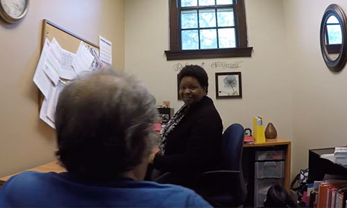 service coordinator barbara in office with resident